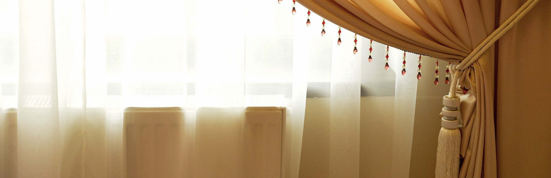bigstock-Beige-Window-Curtain-With-Crys-85377629_resized.jpg